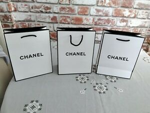 Three x White  CHANEL Gift Bags, including tissue paper. Black Lettering. Empty.