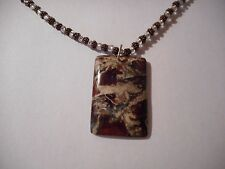 Natural flame jasper gemstone pendant on copper and clear bead necklace
