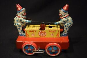 Vintage Tin Wind-up Wyandotte Hoky-Poky Clown push up cart