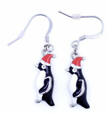 Cute Christmas penguin in a santa hat earrings. Xmas ornament