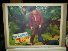 THE HARD MAN, orig 1957 LC #7 [Guy Madison stands over a rustler]