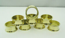 SET OF (8) NAPKIN RINGS - SHINY GOLD TONE BEADED DESIGN w/ STORAGE BOX - NEW