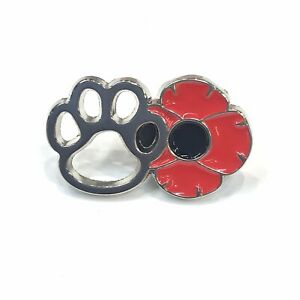 WE REMEMBER THE WAR DOGS. PAW BADGE DONATION GIVEN.