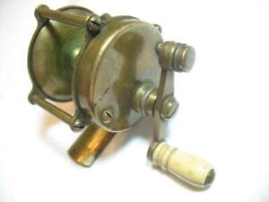 another unknown small brass old fishing reel