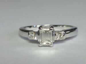 18CT WHITE GOLD 0.34CT EMERALD CUT DIAMOND & 2 X 0.08CT PRINCESS DIAMOND RING