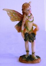 BEAUTIFUL ORNAMENT - A FAIRY STANDING HOLDING ORANGE SCARF GREEN LEAF SKIRT