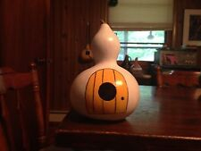 gourd birdhouse feeder painted white with yellow door