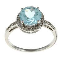 10k White Gold Round Blue Topaz and Diamond Ring (1/8 TDW)