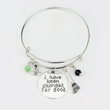 WICKED THE MUSICAL I HAVE BEEN CHANGED FOR GOOD CHARMS BANGLE BRACELET SILVER