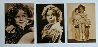 Three reproduction Shirley Temple Postcards - one with Shirley Temple doll
