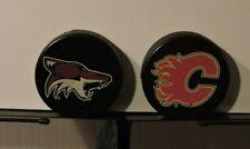 Set of 2 Coors Light NHL Bottle Opener Pucks: Calgary Flames and Phoenix Coyotes
