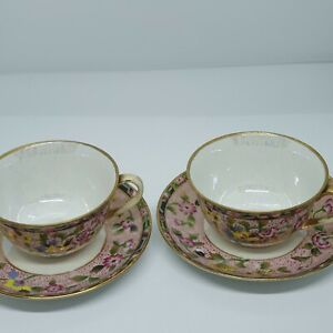 PAIR OF BEAUTIFUL HAND PAINTED AND GILD NORITAKE CUPS AND SAUCERS.