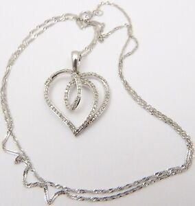 9 carat white gold diamond set double heart pendant 18 inch long necklace.