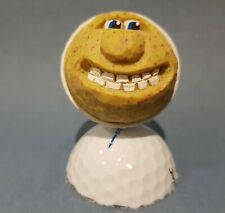 Hand carved and hand painted golf ball
