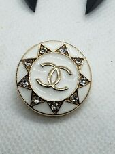 1 white and gold button with rhinestones 27 mm