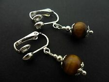 A PAIR OF SHORT TIGERS EYE   BEAD  DROP CLIP ON EARRINGS. NEW. 8MM.