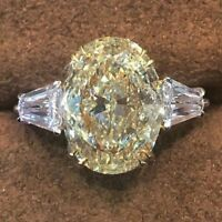 Certified 5.50Ct Canary Yellow Oval & Baguette Accent Ring in14K White Gold