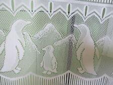 rideaux L 45 cm neuf avec pingouins  vendu par tranche de 22  cm