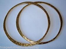 Pair of elegant studio made hand-beaten sterling silver gilt thin bangles