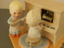 "Hallmark Betsey Clark Musical Decoration ""I'd Like to Teach the World Sing"""