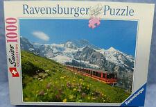 19128. Puzzle  Jungfraubahn vor der Jungfrau  1000 Teile   Ravensburger