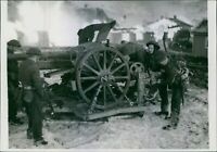 British troops examine a German field gun during their occupation of the island