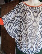SWEET PEA Anthropologie Ikat Sheer Blouse Dolman sleeve orange black white S