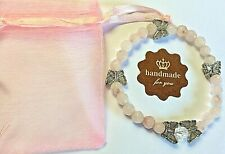 ROSE QUARTZ FACETED BEADED BRACELET WITH BUTTERFLY CHARMS and CLEAR QUARTZ