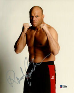 RANDY COUTURE SIGNED AUTOGRAPHED 8x10 PHOTO UFC MMA LEGEND CHAMPION BECKETT BAS