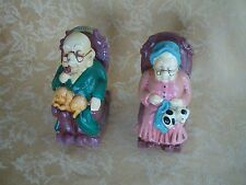 PAIR VINTAGE PIGGY BANK OLD MAN & WOMAN ON ROCKING CHAIR CAT KITTY/DOG ON LAP