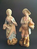 Copyright L & M Inc. Man & Woman Figurines Ceramic Bisque Colonial Statues