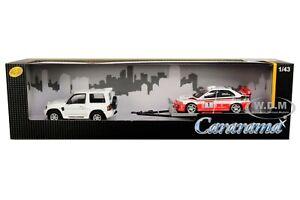 MITSUBISHI PAJERO W/TRAILER & MITSUBISHI LANCER EVO #1 1/43 CAR CARARAMA 48130 M