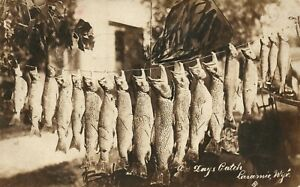 LARAMIE WYO FISHING CATCH ANTIQUE 1922 REAL PHOTO POSTCARD RPPC w/ CORK CANCEL