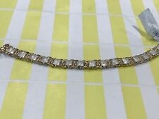 "7.25"" STERLING SILVER AND YELLOW GOLD HUGGS & KISSES BRACELET"
