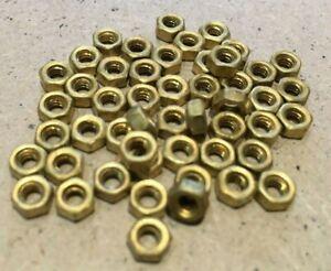 6 BA Brass Nuts.