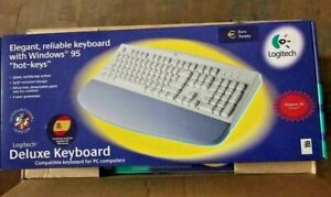 NEW LOGITECH DELUXE AT PS2 KEYBOARD WITH WRIST REST IN FULL RETAIL BOX