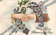 Lover's Hands Clasped Thru Horseshoe Made of Primroses & Snowdrops-1911 Birthday