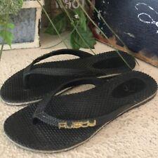 Rusty black flip flops