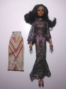 MEGO DIANA ROSS DOLL AND CLOTHES LOT. DOLL IS MELTED AT THE JOINTS AND WAIST TLC