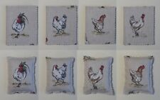 Handmade needle books and pin cushions. Linen look cotton with a chicken print.