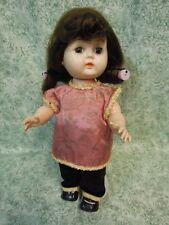 "jk-103 1950's doll: hard plastic in original outfit; walker 10"" tall; brunette"