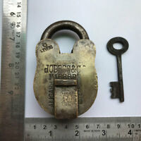 An old or antique solid brass aligarh padlock lock with key
