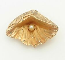 BROOCH pearl shell, imitation pearls, rhinestones, gold-tone metal