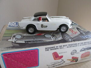 vintage 1960's 1/32  scale Monogram chassis with a MPC Triumph body kit .