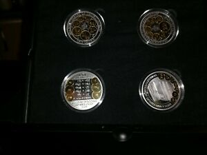 FOUR COINS – each struck from 1oz of Silver with Gold-Plating coa is 417