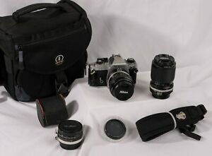 Nikon FG with Nikkor Micro and Zoom lenses, 2x extender, CP filter and bag