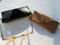 Antique reading glasses and vintage Ray-Ban sunglass case