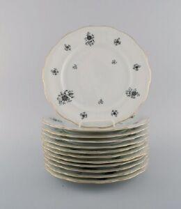KPM, Denmark. 12 Rubens dinner porcelain plates with floral motifs, gold edge.