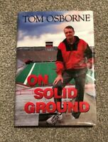 NEBRASKA FOOTBALL TOM OSBORNE SIGNED / AUTOGRAPHED ON SOLID GROUND - PLAYER COA