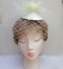 Ivory White Wedding Fascinator with Birdcage Style Veil